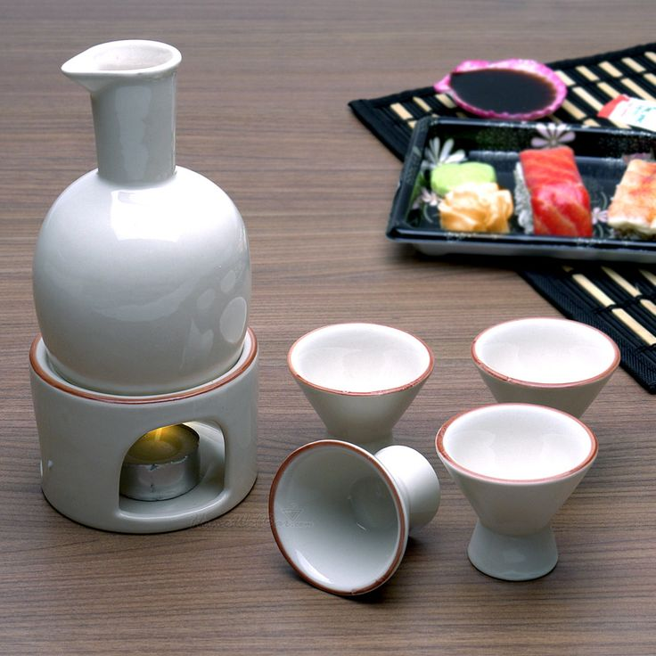 Kampai! The simple sophistication of this sake serving set makes presenting and drinking your sake (rice wine) a uniquely authentic experience. Perfect for serving chilled or hot sake, this traditional set includes a tea light warmer to help keep your sake heated and delicious. This delightful Japanese sake set includes four 1oz choko (sake cups) and one 6oz tokkuri (small carafe). Arrives gift boxed.
