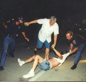 The Detroit Newspaper Strike 1995. Police Sargent from Sterling Htgs. kicking striker. He said there was no police violence on picket line. This is him in plain clothes in center. We had T shirts made with this picture on it. Photo taken by Daymon Hartley. Sargent's first name was Jack. We called him Jack the Kicker.