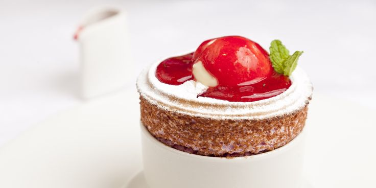 Raspberry Souffle with Coulis and Ice Cream