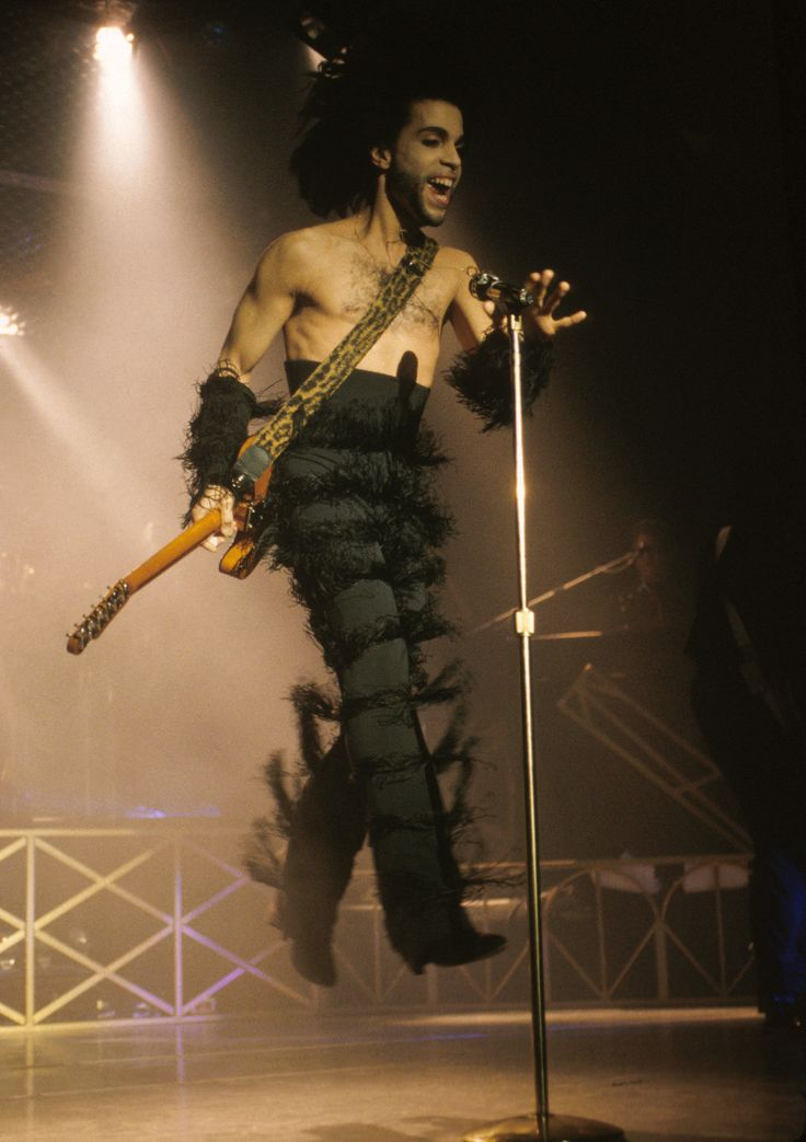 In August 1990, Prince performs onstage — in a pair of high-waisted, tier-fringed pants and matching armbands — in his hometown of Minneapolis, Minn.