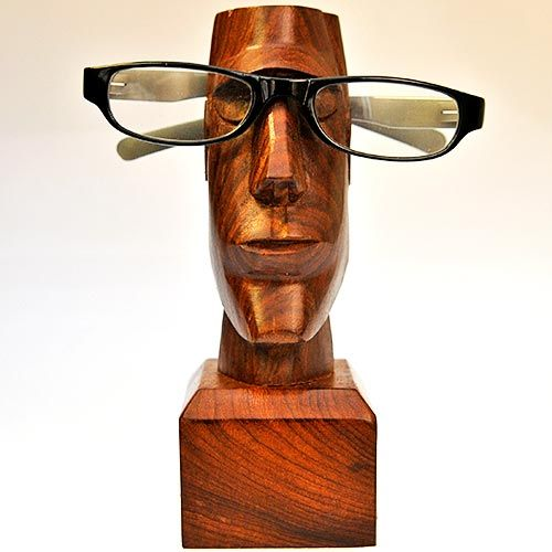 The latest addition to our range of spectacle stands - like the copper/gold ones, but in glorious polished Sheesham wood. Put one on your mantelpiece and be transported to Easter Island (in your imagination!) - then put your specs on the holder and have a good laugh at how much it looks like a TV celebrity from way back when - just add a bow tie!  Width : 63mm Depth : 73mm Height : 177mm