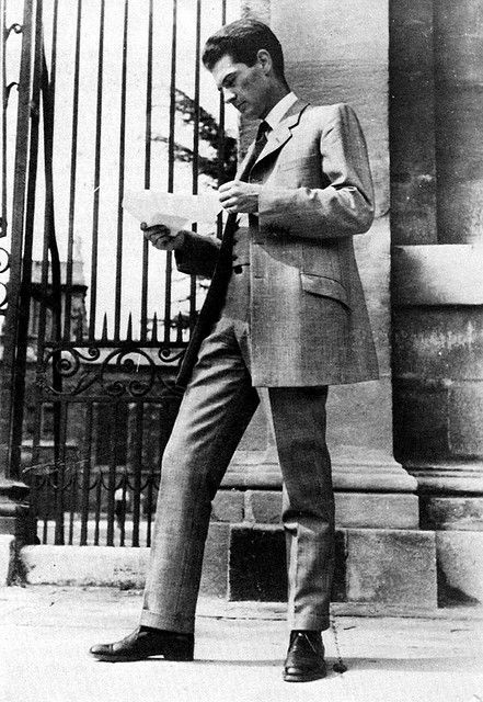 The origins of the #Teddy_Boys go back to the late 1940's when #Saville_Row Tailor's attempted to revive the styles of the reign of King #Edward_VII, 1901-1910, known as the Edwardian era, into men's fashions.His jacket is generously skirted and button-four with a very short lapel and squarely-cut fronts.  Jacket pockets are slanted and are offset by narrow trousers (narrow all the way - not pegged topped) and double breasted waistcoat.