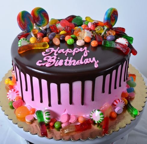 Pastry Palace Las Vegas Birthday Cake 1311 - Birthday Sweets. This absolutely mouth-watering concoction begins with a single tier, dressed in cotton-candy pink, then topped with rich dark chocolate that is painstakingly drizzled down the side of the cake, creating an effect that just oozes with sweets and more sweets. All around the base of this design are peppermints, gummy worms, butterscotch drops, gumdrops, Jelly Belly gourmet jelly beans, Skittles, and almost anything else you can…