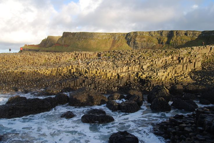 """Giant's Causeway (Ireland) """"It looks like the beginning of the world, somehow: the sea looks older than in other places, the hills and rocks strange, and formed differently from other rocks and hills—as those vast dubious monsters were formed who possessed the earth before man…When the world was moulded and fashioned out of formless chaos, this must have been the bit over—a remnant of chaos! """" - William Makepeace Thackeray"""