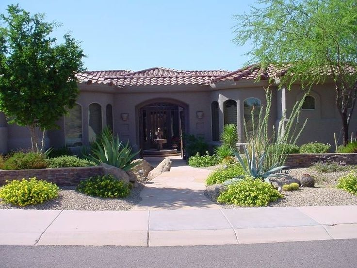well balanced front yard design with stone walls and shrubs welcome ...