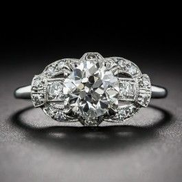 1.22 Carat Art Deco Diamond Ring  GIA K - VS2 by Hayden Wheeler: A beautiful,original late Art Deco engagement ring - circa early-1930s. Die-sruck and hand-finished in platinum with classic, stylized stirrup motif shoulders, this distinctive dazzler stars a bright and shining European-cut* diamond, weighing 1.22 carats,bearing a GIA Diamond Grading Report stating: K color - VS2 clarity. #langantiques #artdecojewelry