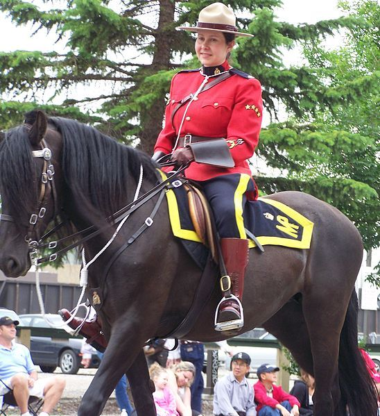 File:RCMP officer on a horse.JPG The first female Royal Canadian Mounted Police! They only use the horses for ceremonies, now.