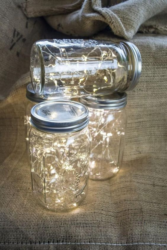 Wide mouth Mason jar fairy lights. Perfect table decor for rustic weddings!