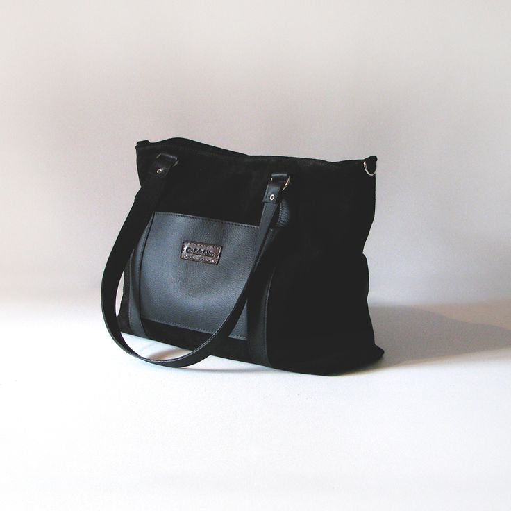 The Big Betty tote is handmade from soft  black jersey suede with cowskin leather detailing.