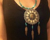 Etsy Treasury List of Etsy Finds from Etsy Shops  Feather Motifs  Etsy Treasury List of Etsy Finds from Etsy Shops  Feather Motifs  Feather Motifs  Feather motif designs  Statement Feather Necklace/Disk Pendent Statement Piece/Feather and Turquoise Necklace/Dreamcatcher Statement Piece II  MyBelleMotifs  $50.00  Turquoise Malachite & Mother of Pearl Sterling Silver Pin/Pendant Mudhead Motif  CrystalynStudio  $275.00  80s Rocker Girl Feather Earrings Three Pair of Feather Motif earrings Huge…