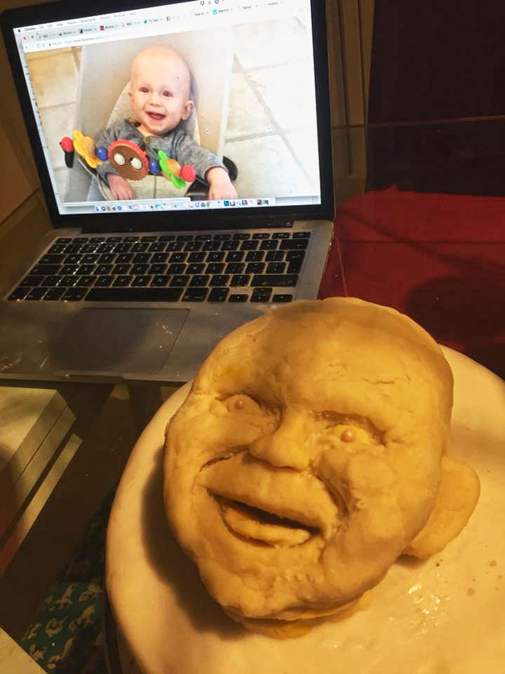 Horrific marzipan baby head on Christmas cake! http://ift.tt/2BEBv2Z