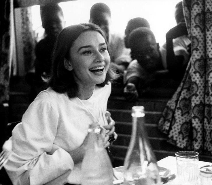 Audrey Hepburn in a cafe of the Congo Market during The Nun's Story 1959
