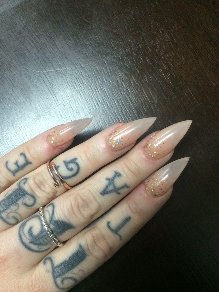 Nude stiletto nails with gold glitter ✨