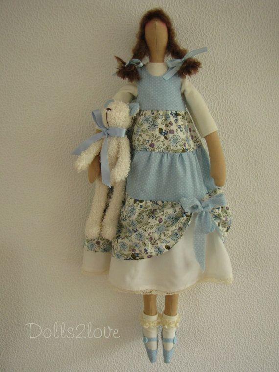 Tilda doll Harper wearing a blue liberty fabric door Dolls2love