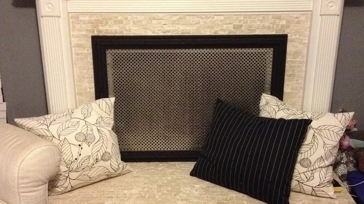 DIY decorative fireplace screen - drop a perforated aluminum sheet (I got mine from Home Depot) into a picture frame.  Hot glue where the metal meets the wood on the back and violà!  Or how about smaller ones with hinges so you can move it about better.