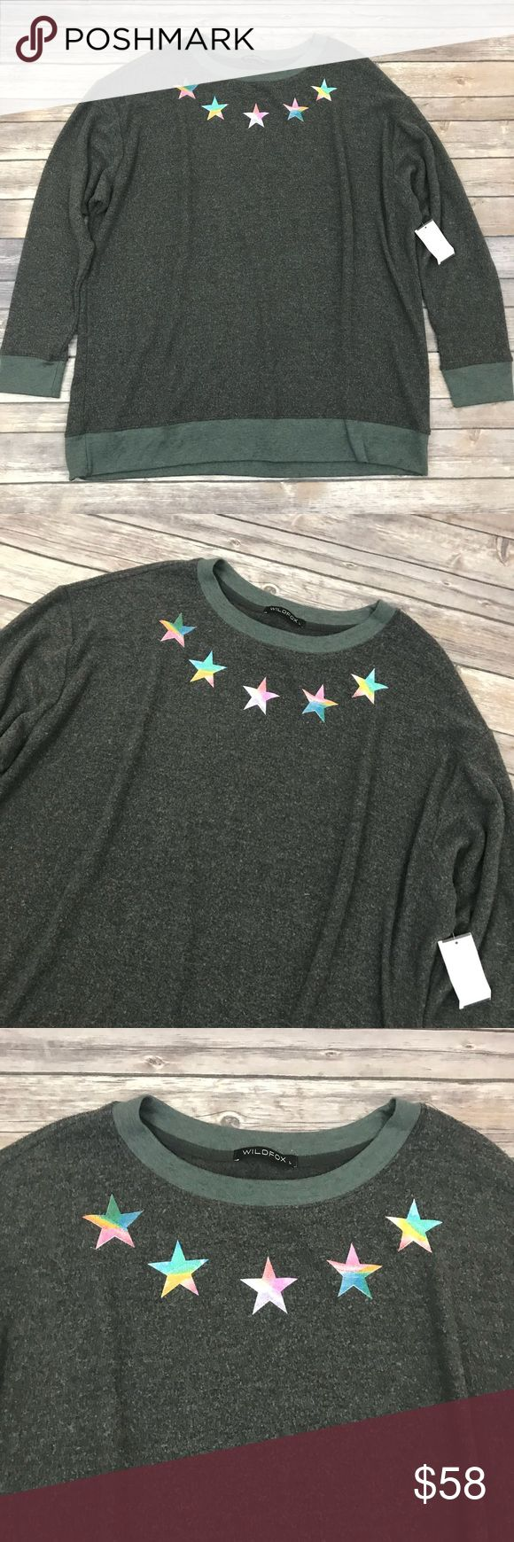 New Wildfox Rainbow Stars Pullover Sweater Wildfox Rainbow Stars Baggy Beach Jumper Pullover Sweater •New with tags •Size Large •Retails for $108  Check out my other listings- Nike, adidas, Michael Kors, Hunter Boots, Kate Spade, Miss Me, Rock Revival, Coach, Wildfox, Victoria's Slecret, PINK, True Religion, Ugg Australia, Free People and more! Wildfox Sweaters Crew & Scoop Necks