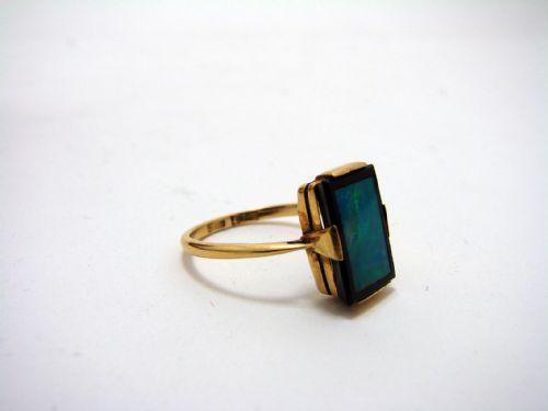 an 18ct gold art deco opal and onyx ring.  I love the idea of a dark opal set within a black border ,  Shweta Kurtkoti
