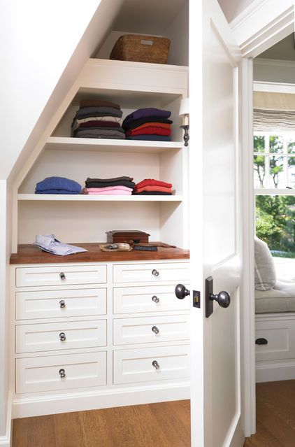 Building in drawers under the eaves or in a knee wall niche provides storage and function. (designed by Woodmeister Master Builders)