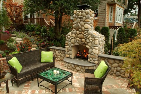 Our outdoor fireplace looks sorta like this except for it has an oven in the middle...well shape wise..soon it will have river rock on it...excited. Giving myself some ideas of what it will look like.