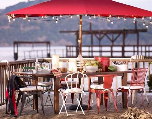 red market umbrella with lights bordering the edge!!!  love the mix of metal chairs too