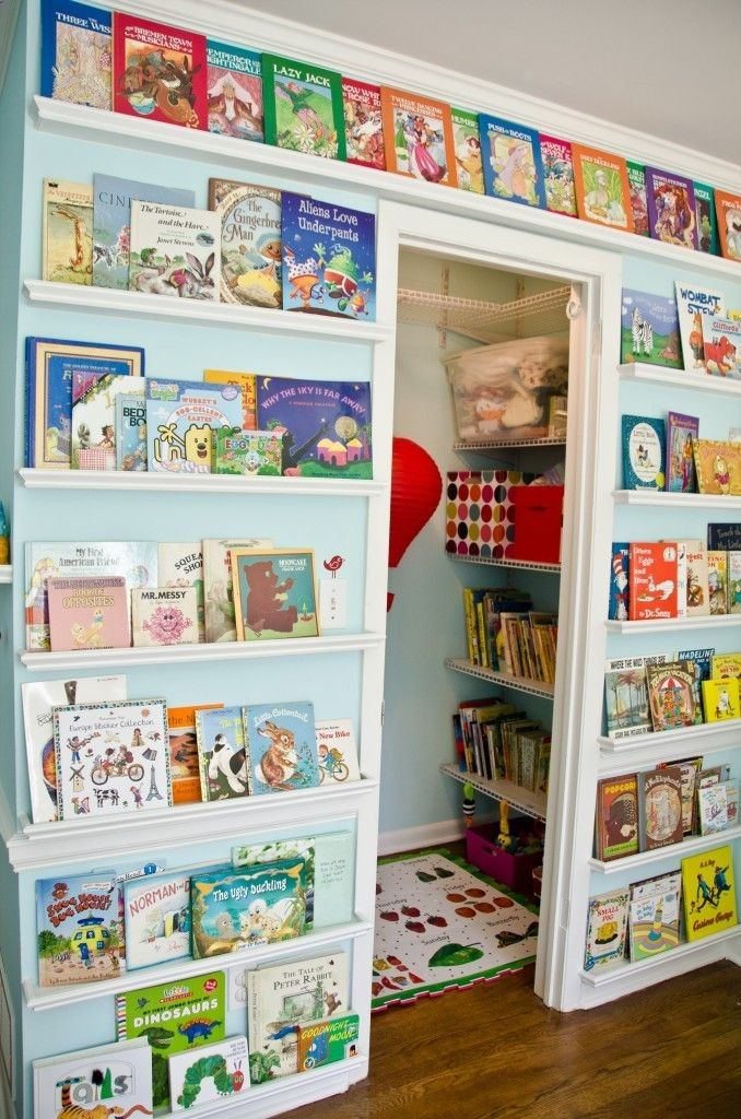 Wall of books and view into closet/mini-playroom | Project Nursery