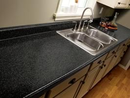 Oh my goodness, I can paint our ugly countertop? This would be GREAT to do with a backsplash for selling the house. YEAH!