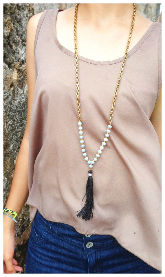 This Long Chain Necklace is made of antique bronze chain and gray crystal beads in elegant combination of black tassel. Necklace is completely