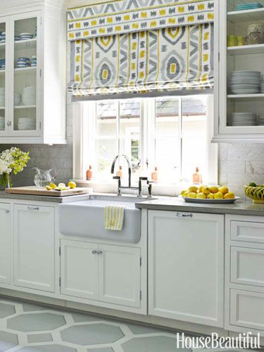 White Kitchen with Yellow Accents.    fabulous roman shade in kitchen designed by Lindsey Coral Harper. Photo by House Beautiful.