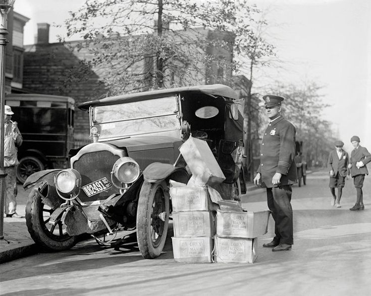 A Police Officer Keeps Watch Over Crates Of Moonshine