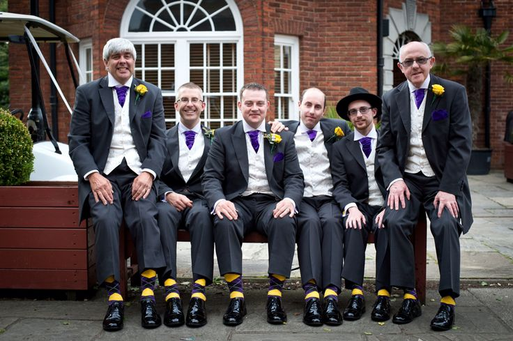 Groomsmen in matching suits and socks