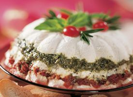 Pesto and Sun-Dried Tomato Torte    Make-ahead recipe! A buffet table becomes beautiful with lovely layers of cream cheese, pesto and sun-dried tomatoes. Serve with sliced baguette