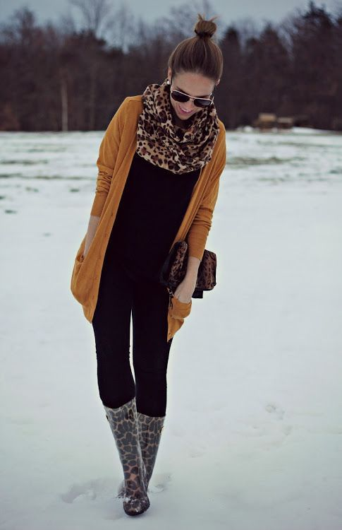 Shop this look for $227:  http://lookastic.com/women/looks/scarf-and-cardigan-and-crew-neck-t-shirt-and-crossbody-bag-and-skinny-jeans-and-rain-boots/1484  — Brown Leopard Scarf  — Tobacco Cardigan  — Black Crew-neck T-shirt  — Brown Leopard Leather Crossbody Bag  — Black Skinny Jeans  — Brown Leopard Rain Boots