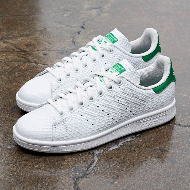adidas Originals gives the classic Stan Smith a makeover through the use of  a honeycomb gloss texture on the white leather upper.