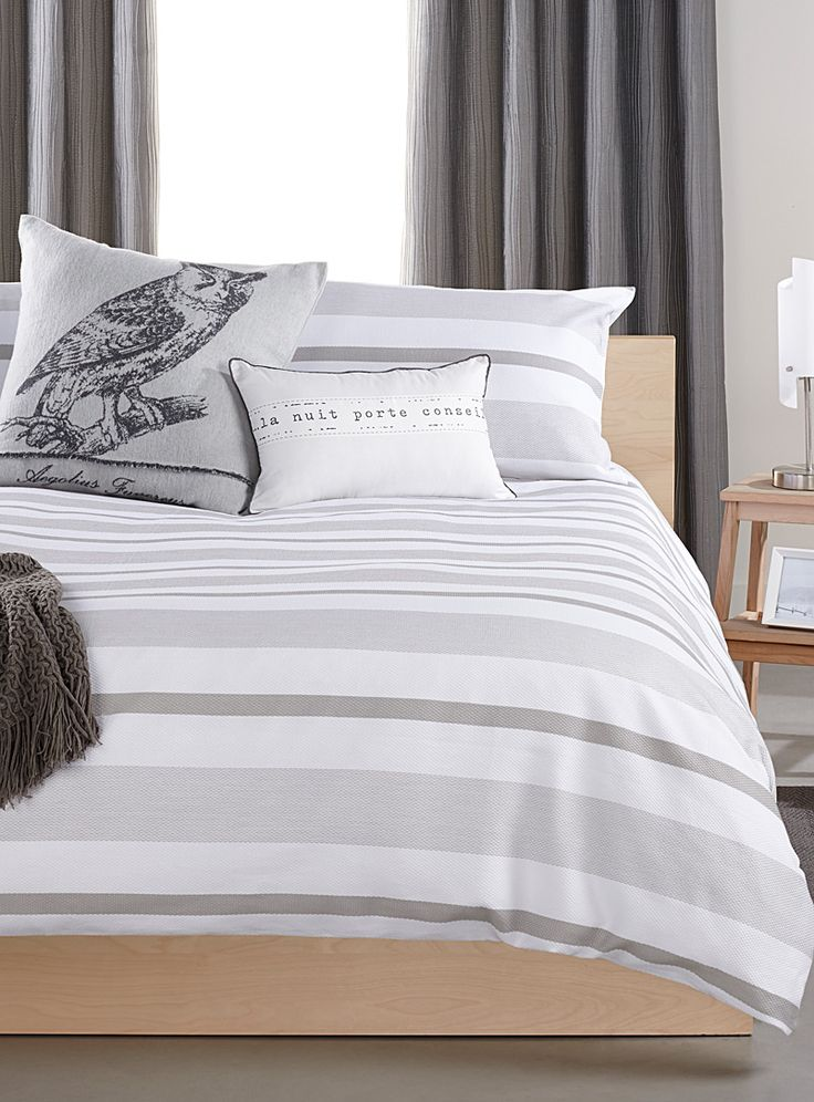 """Exclusively from Simons Maison Minimalist and elegant chic neutral colours in embossed textured stripes on colourfast 100% cotton weave. The set includes: Twin: 1 duvet cover 66"""" x 90"""", 1 pillow sham 20"""" x 26"""" Double: 1 duvet cover 84"""" x 90"""", 2 pillow shams 20"""" x 26"""" Queen: 1 duvet cover 90"""" x 95"""", 2 pillow shams 20"""" x 29"""" King: 1 duvet cover 108"""" x 95"""", 2 pillow shams 20"""" x 36"""" *Home decor shown is for illustrative purposes only."""
