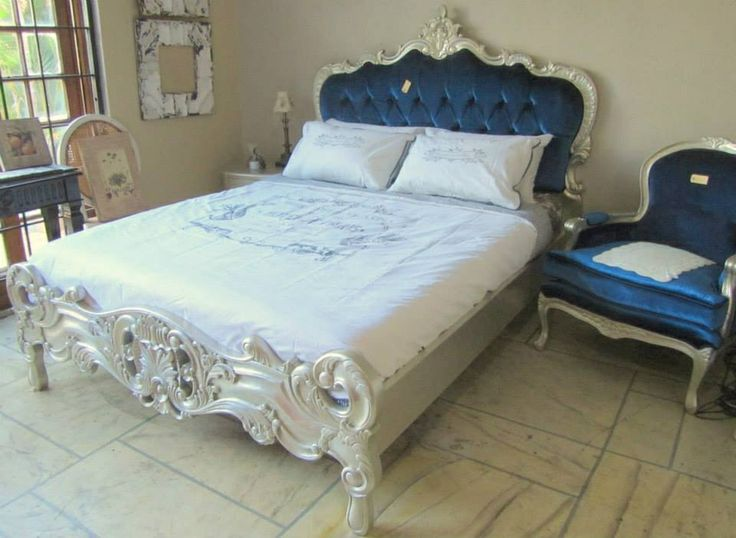 Rococo styled bed with button tuft upholstery. Timeless