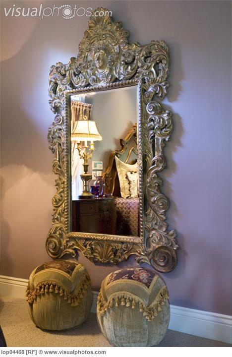 Large ornate mirror on purple bedroom wall hollywood for Large mirror for bedroom wall
