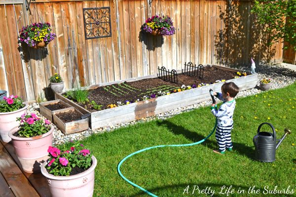 "How Does Your Flower Garden Grow? - A Pretty Life In The Suburbs - like the ""fencing"" dividers in raised garden bed"