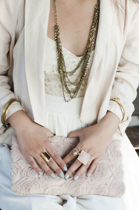 antique gold jewelry on white. love