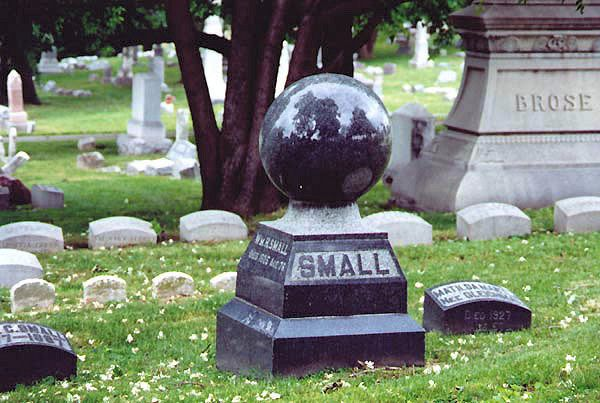 A sphere-topped gravestone.