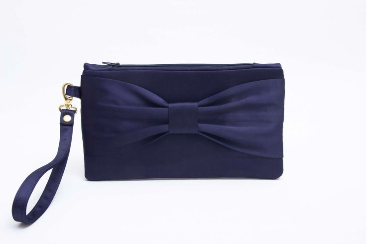 A personal favorite from my Etsy shop https://www.etsy.com/listing/183926680/bow-wristlet-clutchbridesmaid-clutch