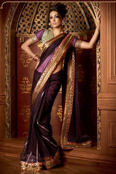 The background is gorgeous, as is the #sari . It's got the brown that lots associate with the #steampunk aesthetic, and then some great kicks of colour, too. And slightly puffed sleeves.
