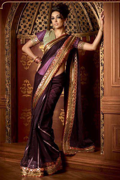 A burgundy saree from Designer Neeta Lulla