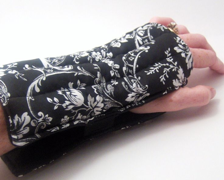 Wrist Heat Wrap, Hot Cold Therapy Pack, Slip On Rice Flax Comfort Pad for Wrists, black and white. $24.95, via Etsy.