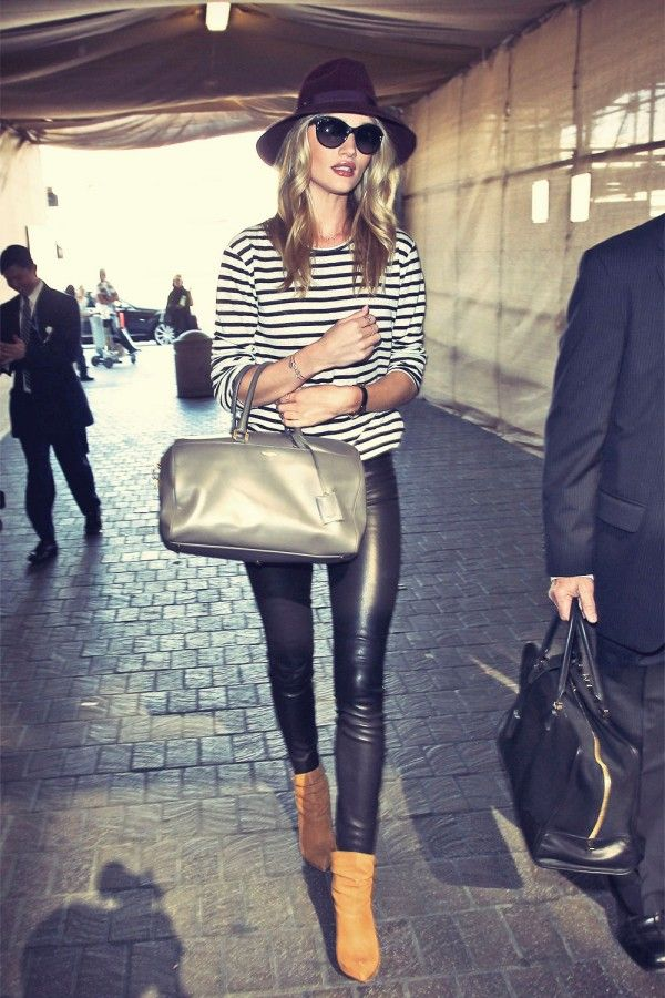 Rosie Huntington-Whiteley arriving at LAX Airport on her way to London wearing our classic leather leggings.