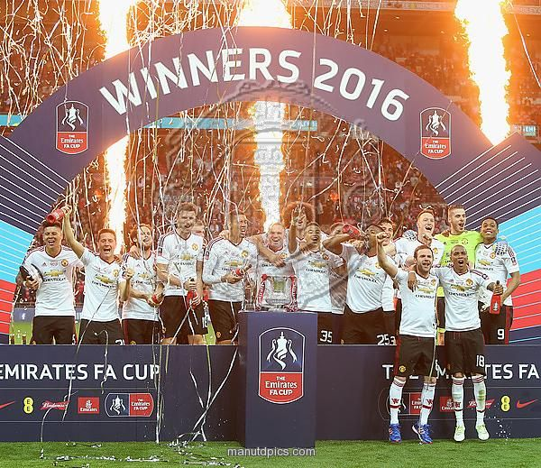 LONDON, ENGLAND - MAY 21: The Manchester United squad celebrate with the FA Cup trophy after The Emirates FA Cup final match between Manchester United and Crystal Palace at Wembley Stadium on May 21, 2016 in London, England