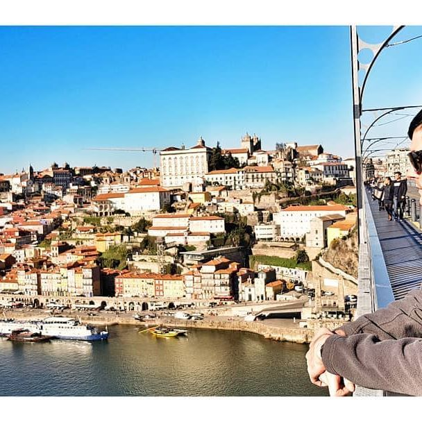 Dom Luis Bridge connecting Porto and Vila Nova de Gaia is a perfect spot to enjoy the amazing views as long as you stay away from the trams riding on it.  #domluisbridge #porto #portoworld #ribiera #traveler #marinearoundtheworld #photogram #architecture #portuguesearchitecture #topportophoto #livingdestinations #rebornphoto