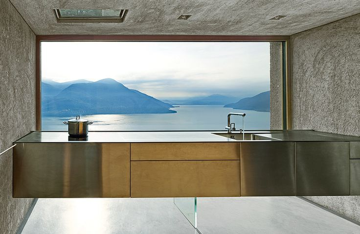 The kitchen of a vacation house by Wespi de Meuron Romeo Architetti overlooks Switzerland's Lago Maggiore.