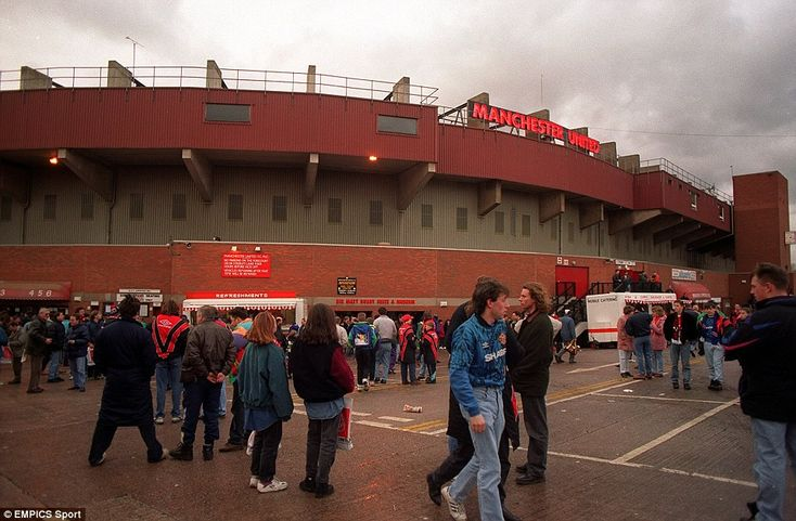 The Sir Matt Busby Suite, which fans used as a rendezvous point is seen here being used to full effect by United disciples who gather outside the exterior of Old Trafford in 1993