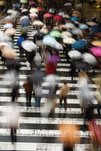 Blurred umbrellas on a city street. Amazing use of a slow shutter speed. #photography
