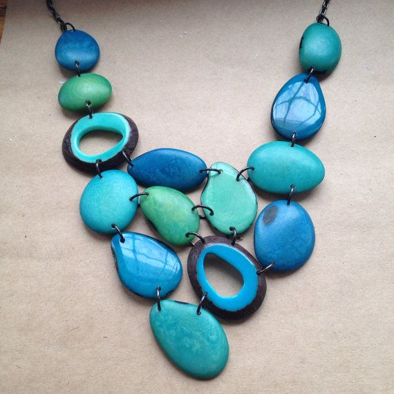Tagua nut jewelry // turquoise necklace // tagua by SelaDesigns, $80.00.  Not only do the supplies purchased to make this necklace benefit artisans in an impoverished country, but all profit from the sale of Sela Designs Jewelry is donated to charity. The purchase of this necklace helps both domestically and internationally.
